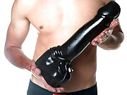 The Super Manly Cock with Balls is a huge rubber dildo measuring 14 inches long and 3 inches wide