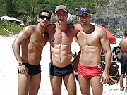 Sexy amateur hunks posing in their trunks on the beach