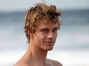 Luke Mitchell hangs around at the beach shirtless and sporting a yummy six-pack