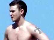 Sexy singer Justin Timberlake grabs his cock