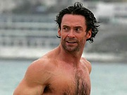 Australian beefcake Hugh Jackman shows off abs and pecs